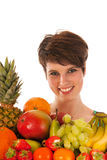 Pretty woman with fresh fruit Royalty Free Stock Image