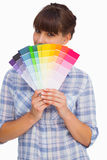 Pretty woman with fringe showing colour charts Royalty Free Stock Photo