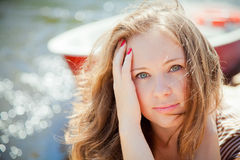 Pretty woman in front of the boat royalty free stock photo