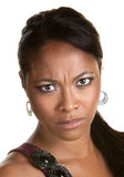 Pretty Woman Frowning. Young African woman frowning over white background stock photos