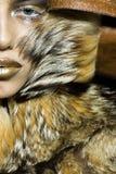 Pretty woman in fur coat Royalty Free Stock Image