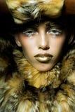 Pretty woman in fur coat Royalty Free Stock Photos