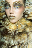 Pretty woman in fur coat Royalty Free Stock Photography