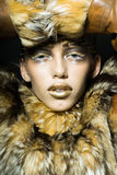 Pretty woman in fur coat Stock Photography