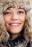 Pretty woman with fur hat Stock Photos