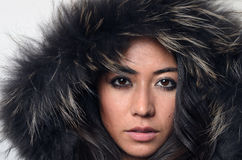 Pretty woman in a furry hood Royalty Free Stock Photography