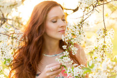 Pretty woman in garden. Young female outdoors photo stock photography