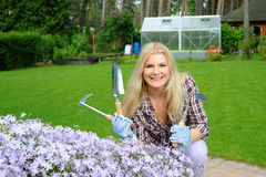 Pretty woman with gardening tools outdoors Royalty Free Stock Image