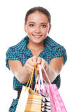 Pretty woman gave bags for shopping Stock Photos