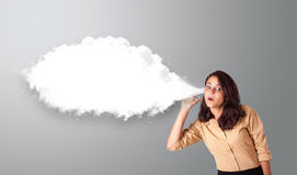 Pretty woman gesturing with abstract cloud copy space Stock Images