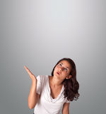 Pretty woman gesturing with copy space Stock Photos