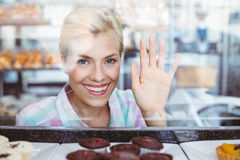 Pretty woman gesturing a greeting Stock Photos