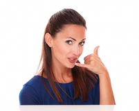 Pretty woman gesturing a phone call Stock Images