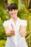 Pretty woman gesturing thumbs up before spa day Royalty Free Stock Photography