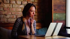 Pretty woman gets acquainted with male person by Internet using laptop at cafe. Beautiful woman gets acquainted with handsome man by Internet using laptop at stock video footage