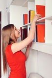 Pretty woman getting the book Stock Image