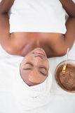 Pretty woman getting a chocolate facial treatment Stock Images