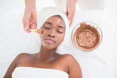 Pretty woman getting a chocolate facial treatment Stock Photos