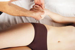 Pretty woman getting hand massage Stock Photos