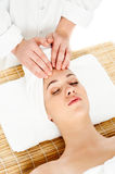 Pretty woman getting head massage Stock Images