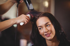 Pretty woman getting her hair dried Royalty Free Stock Photography