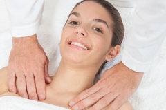 Pretty woman getting massage Royalty Free Stock Photos