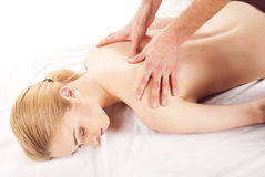 Pretty woman getting shoulder and back massage Stock Image