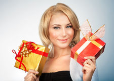 Pretty woman with gifts Royalty Free Stock Image