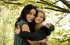 Pretty woman and girl autumn. Pretty women with black hair  and  cute girl, autumn Stock Photos
