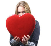 Pretty woman giving a big red heart stock images