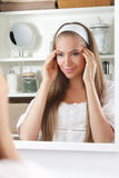 Pretty woman giving a face massage Stock Photos