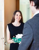 Pretty woman giving gift to man Royalty Free Stock Image