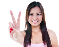 Pretty woman giving peace sign Stock Photography