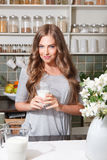 Pretty woman with a glass of milk Stock Photography