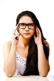 Pretty Woman in Glasses. A pretty Asian woman in eyeglasses thinking Royalty Free Stock Image