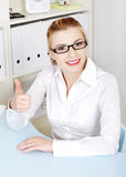 Pretty woman in glasses showing okay gesture. Stock Photography