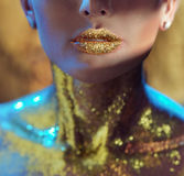 Pretty woman with golden lips. Pretty young woman with golden lips Royalty Free Stock Photo