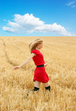 Pretty woman in golden wheat Royalty Free Stock Images