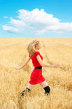 Pretty woman in golden wheat Royalty Free Stock Photo