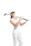 Pretty woman golfer on white background in studio. Pretty woman golfer posing with golf club on white background in studio Royalty Free Stock Image