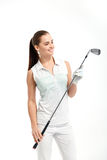 Pretty woman golfer on white background in studio. Pretty woman golfer posing with golf club on white background in studio Stock Photography