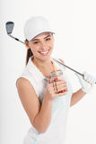 Pretty woman golfer on white background in studio. Pretty woman golfer posing with golf club and ball on white background in studio Stock Photography