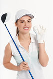 Pretty woman golfer on white background in studio. Pretty woman golfer posing with golf club and ball on white background in studio Royalty Free Stock Images