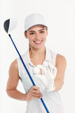 Pretty woman golfer on white background in studio. Pretty woman golfer posing with golf club and ball on white background in studio Royalty Free Stock Photo