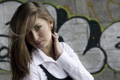 Pretty woman at a graffiti backgrou Stock Photography