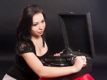 Pretty woman with gramophone Stock Image