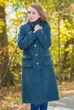 Pretty Woman in Gray Coat on Nature Background Royalty Free Stock Images