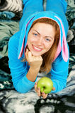 Pretty woman with green apple Royalty Free Stock Image