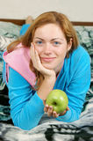Pretty woman with green apple Stock Photos