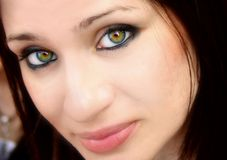 Pretty woman with green eyes Stock Photos